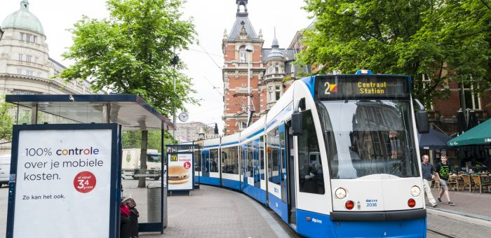 """""""Amsterdam, Holland - May 29, 2012: Tram running in the city centre amongst pedestrians. May 29, 2012 in Amsterdam. The tram network comprises 16 lines and covers 213 kilometres."""""""